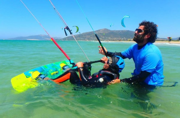 Experieced kitesurfing teacher in the water with you